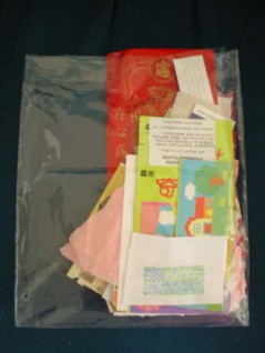 Collage papers sorted into a bag.