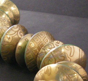 Metal etched red brass and polymer clay beads