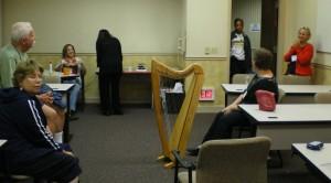 Sue Latsha, Jack Berry, Kristy Mosteller, student, visitor, Donna Ryan-Kocun, Deryn Rocket on the harp