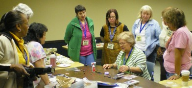 Marie Segal teaching tricks on polymer clay with paints, powders and inks.